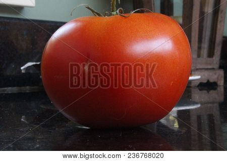 Tomato Isolated. Tomato With Clipping Path. Beautiful Imperfect Tomato Ready To Eat
