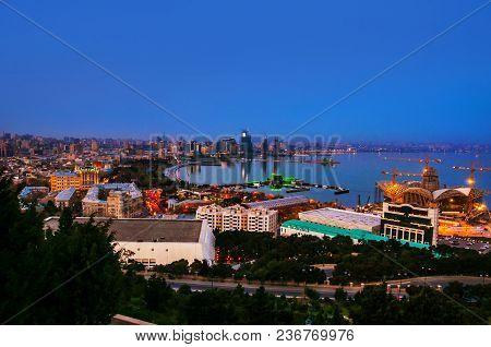 Baku, Azerbaijan. Aerial View Of Baku, Azerbaijan At Night. Coastline Of The Capital Of Azerbaijan W