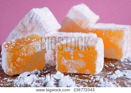 Orange Turkish Delight. Pieces Of Rahat Latucum Closeup. Turkish And Bulgarian Sweets.