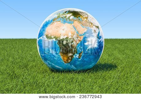 Eco Concept. Earth Globe On The Green Grass Against Blue Sky, 3d Rendering