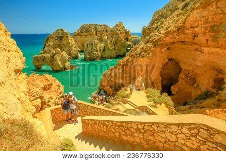 Lagos, Portugal - August 22, 2017: Couples Take Selfie On The Steps Leading Down To The Caves At Pon