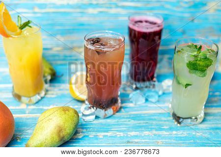 Glasses With Different Refreshing Drinks And Fruits