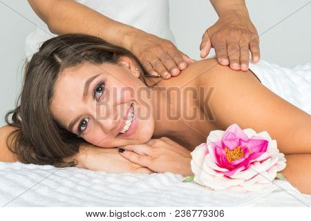 Hispanic woman getting a massage at the spa