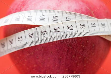 Apple with White Measuring Tape of the Tailor for you Design, Shallow Dept of Field
