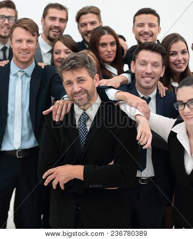 confident businessman standing on background of her business team.