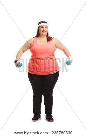 Full length portrait of an overweight woman exercising with dumbbells isolated on white background