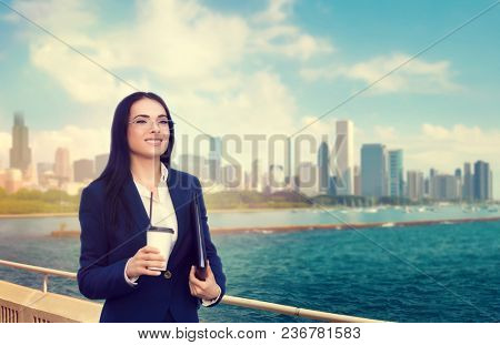 Business woman in glasses and suit, against skyscrapers. Modern building, financial center, cityscape. Successful female businessperson