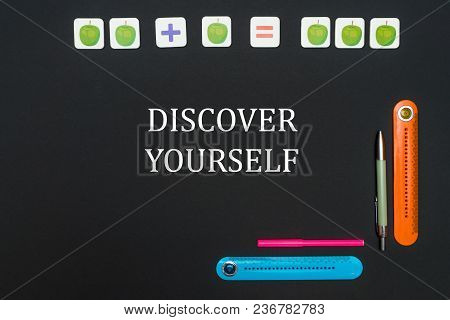 Concept School, Black Art Table With Stationery Supplies With Text Discover Yourself On Blackboard