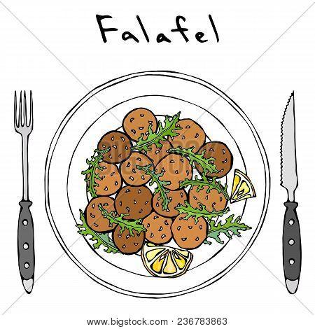 Falafel, Arugula Herb Leaves, Lemon On Plate, Fork, Knife. Middle Eastern Cuisine. Arabic Israel Veg