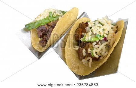 Very Tasty Steak Tacos in Steel Holders Isolated on White
