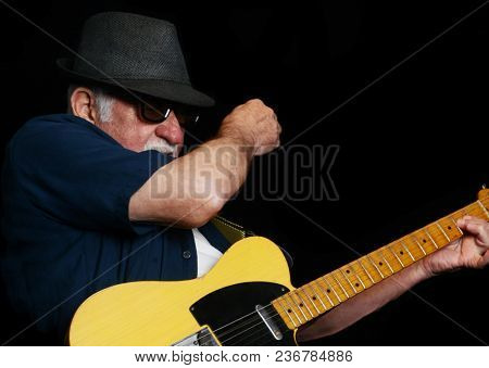 Great close up Image of a senior Rock Guitar Player