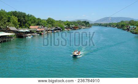 ADA BOJANA, MONTENEGRO - JULY 12, 2017: motorboat with tourists flowing on the Bojana River