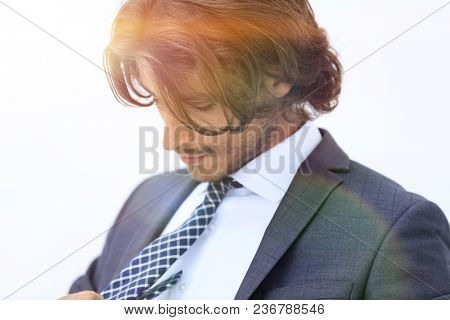 Portrait of well dressed confident man