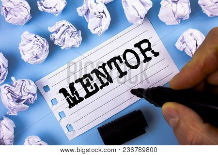 Word Writing Text Mentor. Business Concept For Person Who Gives Advice Or Support To A Younger Less