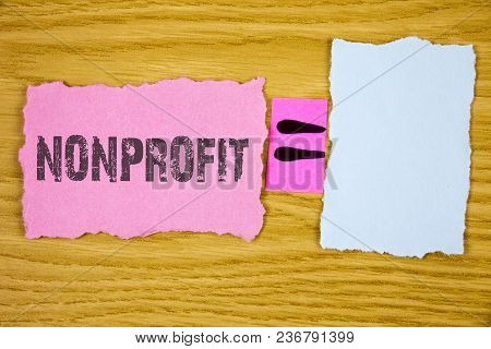 Writing Note Showing  Nonprofit. Business Photo Showcasing Activities That Do Not Generate Revenues
