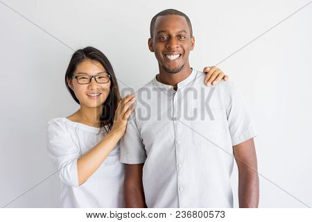 Cheerful Excited Young Multiethnic Couple Laughing And Looking At Camera. Jolly Asian Girl Touching