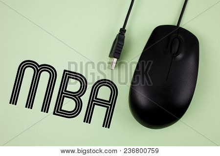 Word writing text Mba. Business concept for Master of Business Administration Advance Degree After College Studies written Plain background Black Mouse next to it. poster