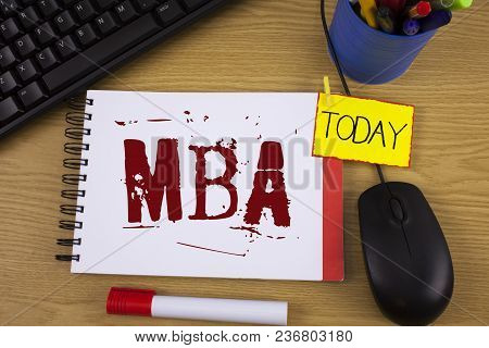 Word writing text Mba. Business concept for Master of Business Administration Advance Degree After College Studies written Noteoad wooden background Today Marker Mouse Keyboard next to it. poster