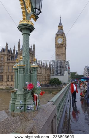 London - July 29, 2017: Flowers Left As A Memorial For The Victims Of The Westminster Bridge Attack