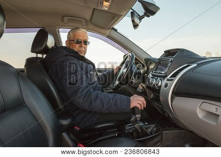 The Man At Mature Age Driving The Car