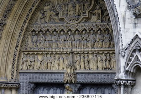 London - July 29, 2017: A Close-up Of The Martyrs On The North Facade Of Westminster Abbey In 1998.