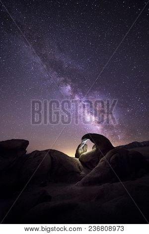 Lanscape View Of The Desert With Stars And Milky Way Galaxy Over The Night Sky.  The Image Depicts A