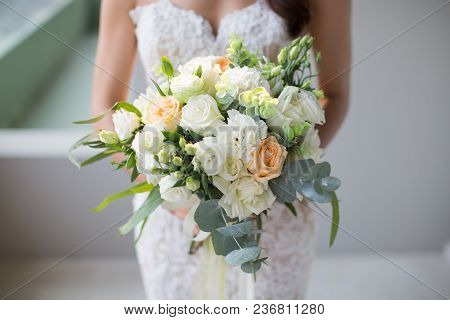 A Girl Carry A Wedding Flower In Her Hand