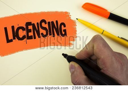 Writing Note Showing  Licensing. Business Photo Showcasing Grant A License Legally Permit The Use Of
