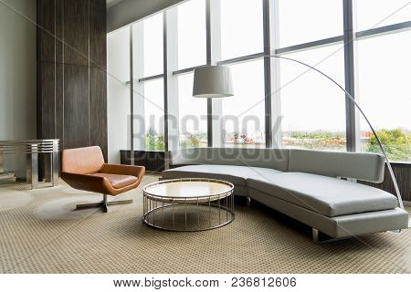 Modern Lounge Room Interior In Office Building. Room With Panoramic Window, Modern Leather Chair, Wh