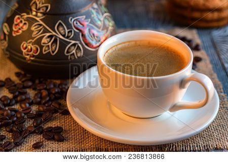 Cup Of Turkish Coffee In Homely Winter And Christmas Settings. Coffee Beans And Cezva. Warm And Hear
