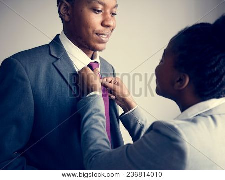 A couple preparing together before leaving home for work