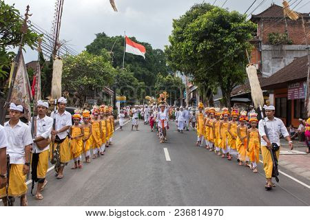 Bali, Indonesia - September 17, 2016: Traditional balinese procession during Galungan celebration in Ubud, Indonesia