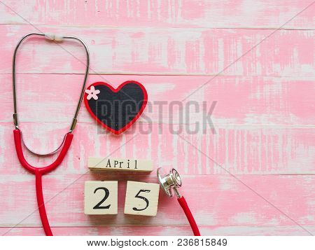 World Malaria Day April 25, Healthcare And Medical Concept. Stethoscope And Handmade Red Heart On Pi