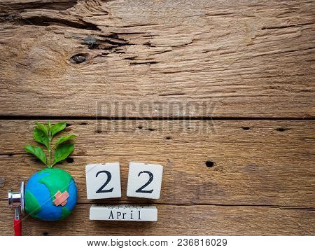 Wooden Block Calendar For World Earth Day April 22, Wooden Block Calendar And Handmade Globe On Wood