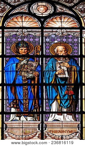 PARIS, FRANCE - JANUARY 10: Saint Paulinus and Saint Jerome, stained glass window in the Saint Augustine church in Paris, France on January 10, 2018.