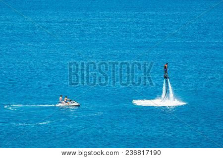 Crete, Greece - June 11, 2017: Flyboard Show On The Vai Beach On The Island Of Crete, Greece. Flyboa