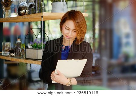 Portrait Woman Checklist On Clipboard With Business Secretary.