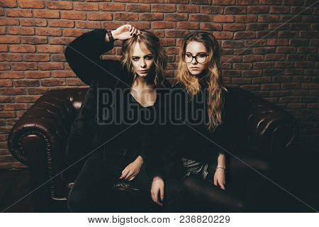 Beautiful blonde women in mink coats posing in a luxurious interior. Fashion, beauty. Winter collection.