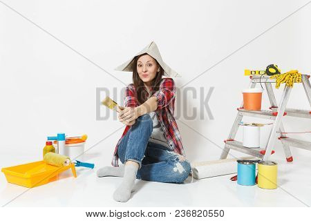 Cute Woman In Newspaper Hat Sitting On Floor With Brush, Instruments For Renovation Apartment Room I
