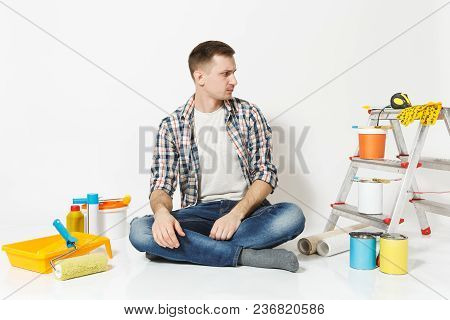 Serious Pensive Man In Casual Clothes Sitting On Floor With Instruments For Renovation Apartment Roo