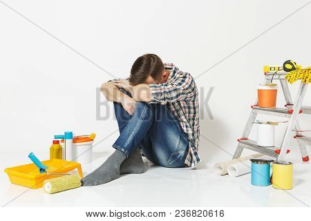 Confused Shocked Annoyed Tired Man Sitting On Floor With Hands On Head Instruments For Renovation Ap