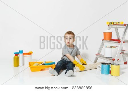 Little Cute Boy In Yellow Gloves With Instruments For Renovation Apartment Room Isolated On White Ba