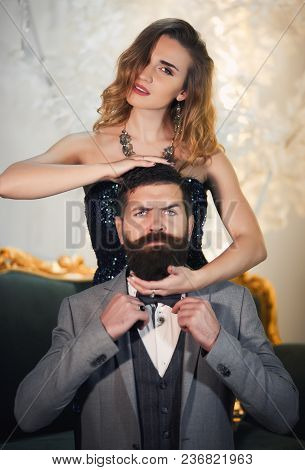 Handsome Man And Beautiful Woman In Elegant Evening Clothes In Classic Vintage Apartments. Glamour,