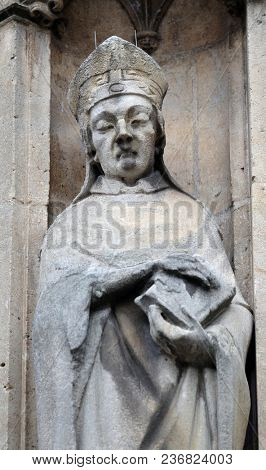 PARIS, FRANCE - JANUARY 11: Saint Cera statue on the portal of the Saint Germain l'Auxerrois church in Paris, France on January 11, 2018.