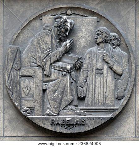 PARIS, FRANCE - JANUARY 11, 2018: Francois Rabelais, French Renaissance writer, physician, Renaissance humanist, monk and Greek scholar. Stone relief at the building of the Faculte de Medecine Paris.