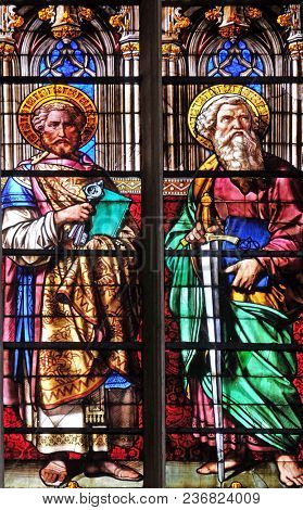 PARIS, FRANCE - JANUARY 11: Saints Peter and Paul, stained glass windows in the Saint Gervais and Saint Protais Church, Paris, France on January 11, 2018.