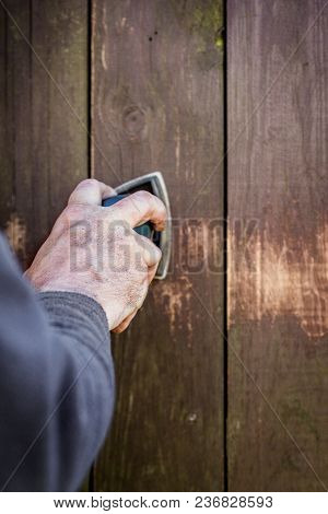 Do It Yourself, Closeup Hand With A Electric Sander On Wooden Boards Or Fence, Copyspace