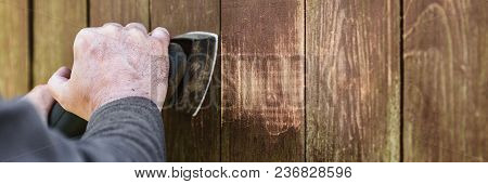 Header, Carpenter Is Sanding Weathered Wooden Boards With A Electric Sander, Copyspace