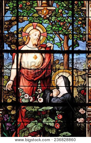 PARIS, FRANCE - JANUARY 11: Apparition of the Sacred Heart to Marguerite Marie Alacoque, stained glass windows in the Saint Gervais and Saint Protais Church, Paris, France on January 11, 2018.