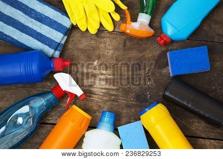 Cleaning Products On Wooden Background. Top View. From Above. Copy Space.